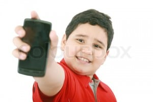 Boy showing his new cell phone